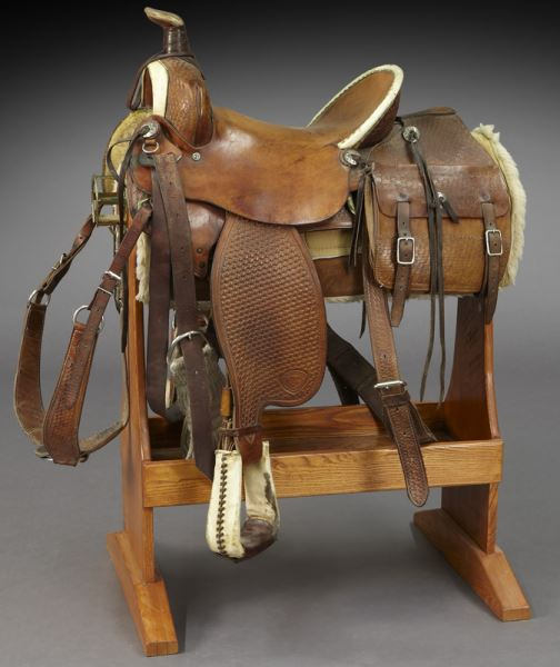 A tooled leather Western style horse saddle marked Hereford